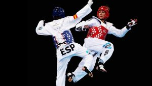 Taekwondo athletes wore socks and clothing fitted with electronic sensors which registered a blow when contact is made